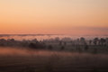 Sunrise over the valley, the sun rises above the horizon, the warm sunshine Royalty Free Stock Photo