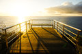 Sunrise pier on a over atlantic ocean in tenerife canary islands spain Stock Photo