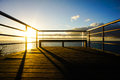 Sunrise pier on a over atlantic ocean in tenerife canary islands spain Royalty Free Stock Images