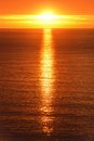 Sunrise reflected on the ocean scenery at with sun gold water Stock Image