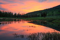 Sunrise reflection in the Uinta Mountains. Royalty Free Stock Photo