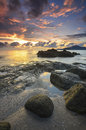 Sunrise at rocky beach in terengganu malaysia image taken with long exposure custom white balance Stock Photo