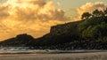 Sunrise rocky coastline boy on at fingal head australia Royalty Free Stock Images
