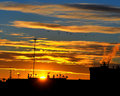 Sunrise on roofs and antennas Royalty Free Stock Images