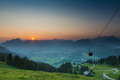 Sunrise with ropeway on mountains moving gondola of while in tyrol Royalty Free Stock Photos