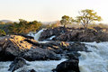 Sunrise at the ruacana falls namibia on border of and angola Royalty Free Stock Images
