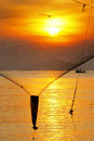 Sunrise at sea a fishing net become a beautiful silhouette in midair Royalty Free Stock Photography