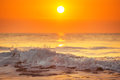 Sunrise and shining waves in ocean shot Royalty Free Stock Images