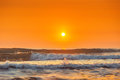 Sunrise and shining waves in ocean shot Royalty Free Stock Photos
