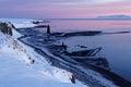 Sunrise on the shoreline of an icelandic fjord landscape Stock Images