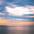 Sunrise sky and ocean sun beams on at early morning Royalty Free Stock Image