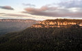 Sunrise from sublime point in blue mountains australia rising sun illuminates clouds and mist the valley overlooking the majestic Stock Photography