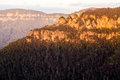 Sunrise from sublime point in blue mountains australia rising sun illuminates three sisters the valley overlooking the majestic Royalty Free Stock Photography