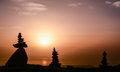 Sunrise at the summit with zen stones and and new day and positive energy success climbing Stock Image
