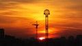 Sunrise sun rising between tower willis terra park and a crane Stock Photos