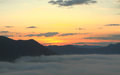 Sunrise timing on the mountain in mist Royalty Free Stock Image