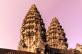 Sunrise and the two towers of Angkor Wat Royalty Free Stock Photo