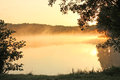 Sunrise view of the foggy lake at Royalty Free Stock Photography