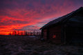 A sunrise in village house against the red dawn Stock Photo