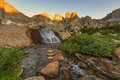 Sunrise waterfall in the Wind River Mountains. Royalty Free Stock Photo