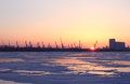 Sunrise at winter over frozen river and seaport in nikolaev Stock Photography