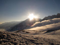 Sunrise wonderful at horizon in winter season with clouds and lot of snow in french alps mountain Stock Photo