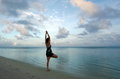 Sunrise yoga on aitutaki lagoon cook islands of young woman the sea coast of Royalty Free Stock Photo