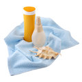 Sunscreen cream and bath towel isolated Royalty Free Stock Photography