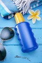 Sunscreen sunblock a bottle of with a blank label towel and sunglasses Stock Photography