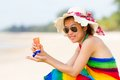 Sunscreen woman girl sun block on beach holding Stock Image