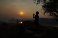 Sunset above mekong river with silhouette of photographer in luang prabang laos Stock Photos