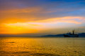 Sunset on Aegean sea with cruise ship silhouette Royalty Free Stock Photo