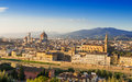 Sunset aerial view of florence with cathedral of santa maria del fiore duomo palazzo vecchio and ponte vecchio in italy Royalty Free Stock Images