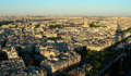 Sunset aerial view of paris from the eiffel tower with its shadow projecting over the city Stock Image