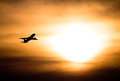 Sunset with airplane Stock Photography
