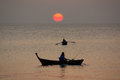 Sunset on the andaman sea thailand fisherman in boat at Royalty Free Stock Image