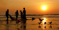 Sunset the arabian sea fishermen dragged ashore network Royalty Free Stock Photo