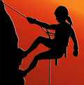 Sunset Back Abseiling Lady Stock Image