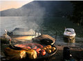 Sunset barbecue with boats Royalty Free Stock Photo