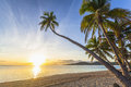 Sunset on beach tropical fiji island Stock Images