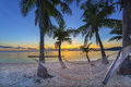 Sunset on beach tropical paradise at with hammock Royalty Free Stock Image