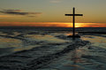 Sunset beach waters cross at with water from a stream pass the to the sea Stock Images