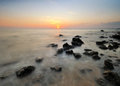 Sunset at beachfront with nature rocks some Royalty Free Stock Photography