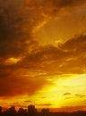 Sunset beautiful golden over a dark cityscape Royalty Free Stock Photography