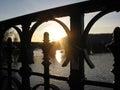 Sunset behind bridge Royalty Free Stock Photo