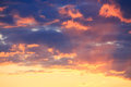 Sunset behind clouds Royalty Free Stock Photo