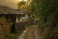 Sunset in bozhentsi thеsе old ethnographic houses are village bulgaria thе ethnographic complex is attractive tourist Royalty Free Stock Image