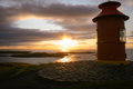Sunset on breidafjordur a view of iceland at the small red lighthouse the right is one of the lighthouses the top of Royalty Free Stock Photo