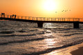 Sunset, Bridge on the sea shore Royalty Free Stock Photography