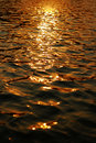 Sunset on calm water Royalty Free Stock Photos